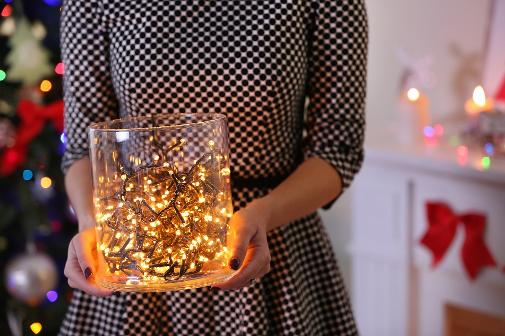Woman holding fairy lights